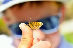 Bbutterfly on the finger Royalty Free Stock Photo