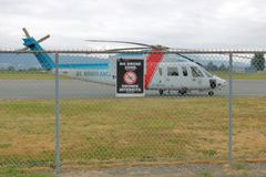 BC Ambulance Helicopter and Drone No Fly Zone. A BC Ambulance helicopter in the Chilliwack, BC airport is used for essential medical emergencies and a sign royalty free stock image