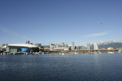 BC Place and South False Creek view. With anchored boats and yachts and snowy mountains Royalty Free Stock Photo