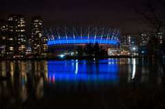 BC Place Stadium. Vancouver, Canada - November 1st, 2012: BC Place Stadium lights up in blue. The cable-supported fabric roof is the largest of its kind in the stock images