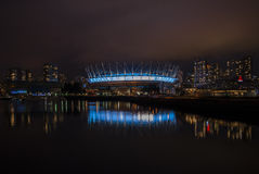 BC Place Stadium in Vancouver, Canada, at Night. Nightime photo of BC Place Stadium in Vancouver, BC, Canada with reflection in the waters of False Creek stock photo