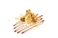BC rotolo croccante fritto nel grasso bollente su bianco Fotografie Stock Libere da Diritti