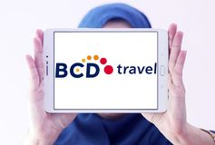 BCD Travel company logo. Logo of BCD Travel company on samsung tablet holded by arab muslim woman. BCD Travel is a provider of global corporate travel management royalty free stock photography