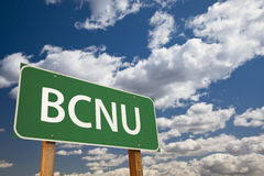 BCNU Green Road Sign Over Sky Royalty Free Stock Photo