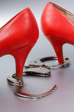Bdsm concept. Handcuffs and sexy  high heels Royalty Free Stock Photo