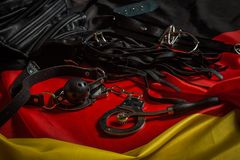 Bdsm toys for pain and pleasure. Laying on german flag Royalty Free Stock Photos