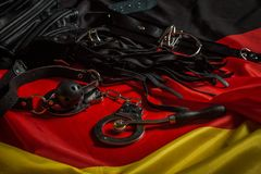 Bdsm toys for pain and pleasure. Laying on german flag Royalty Free Stock Images