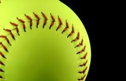 Beísbol con pelota blanda amarillo Imágenes de archivo libres de regalías