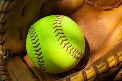 Beísbol con pelota blanda y guante Fotografía de archivo libre de regalías