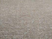 Beżowej tkaniny burlap brezentowej sprawy tkanin tekstury bieliźniany tło zdjęcie royalty free