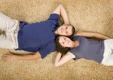 beżowi par dywanowi young obrazy stock