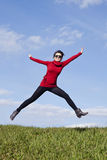 Be active stay healthy - jumping woman Royalty Free Stock Photography