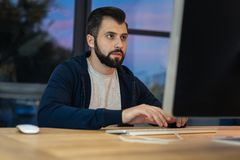 Competent programmer using his computer Stock Image