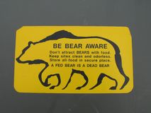 Be aware of bear sign. A yellow be aware of bear sign royalty free stock photos