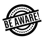 Be Aware rubber stamp. Grunge design with dust scratches. Effects can be easily removed for a clean, crisp look. Color is easily changed Royalty Free Stock Images