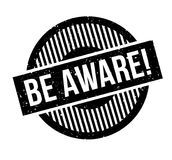 Be Aware rubber stamp. Grunge design with dust scratches. Effects can be easily removed for a clean, crisp look. Color is easily changed Royalty Free Stock Image