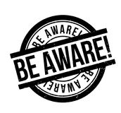 Be Aware rubber stamp. Grunge design with dust scratches. Effects can be easily removed for a clean, crisp look. Color is easily changed Stock Image