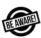 Be Aware rubber stamp. Grunge design with dust scratches. Effects can be easily removed for a clean, crisp look. Color is easily changed Stock Photo