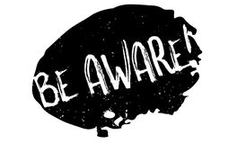 Be Aware rubber stamp. Grunge design with dust scratches. Effects can be easily removed for a clean, crisp look. Color is easily changed Stock Images