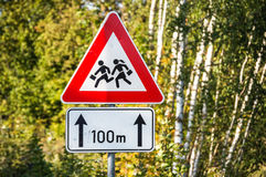 Be aware! Schoolkids!. Photo closeup of road sign warning drivers of near school and schoolkids royalty free stock image