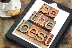 Be the best on a tablet. Be the best - text in letterpress woodtype on a digital tablet with a cup of coffee - motivation concept Royalty Free Stock Photography