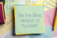 Be the Best Version of Yourself written on a note. Top view of Be the Best Version of Yourself written on a note with a pen aside royalty free stock images