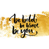 Be bold, be brave, be you. Inspiration saying calligraphy on golden dry brush stroke. Royalty Free Stock Photos