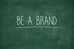 Be a brand handwritten on blackboard Stock Image