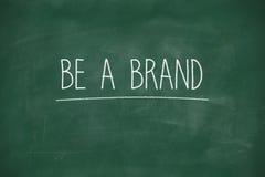 Be a brand handwritten on blackboard stock image