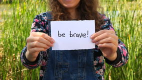 Be brave, beautiful girl showing words stock video footage