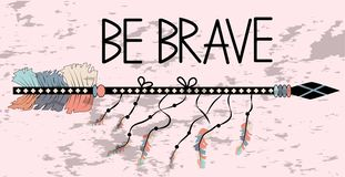 Native american accessory with arrow feathers and lettering be brave. Be brave. Inspirational quote. Modern calligraphy phrase with hand drawn arrows. Lettering stock photography