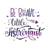 Be Brave Little Astronaut quote. Baby shower hand drawn lettering logo phrase. Vector script style text in space colors with stars and line decor. Doodle space stock illustration
