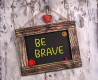 Be brave written on Vintage sign board stock images