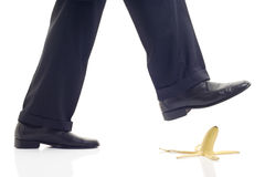 Be careful. Person about to step on a banana peel Stock Images