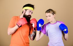 Be careful. Boxing sport concept. Couple girl and hipster practicing boxing. Sport for everyone. Amateur boxing club. Equal possibilities. Strength and power royalty free stock photos