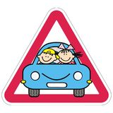 Attention, kids on the car. Red triangle frame. Royalty Free Stock Photo