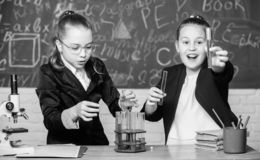 Be careful performing chemical reaction. Basic knowledge of chemistry. Girls study chemistry. Make studying chemistry. Interesting. Educational experiment stock photos