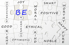 BE concept written on white puzzle, jigsaw Royalty Free Stock Image