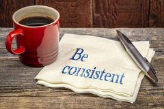 Be consistent concept - handwriting on a napkin stock images