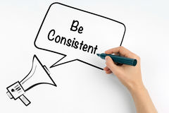 Be Consistent. Megaphone and text on a white background stock photography