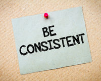 Be Consistent. Message. Recycled paper note pinned on cork board. Concept Image stock images