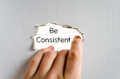 Be consistent text concept stock images
