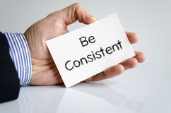 Be consistent text concept stock photography