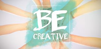 Composite image of be creative. Be creative against directly below shot of friends stacking hands Stock Images