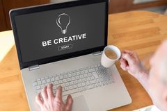 Be creative concept on a laptop. Man using a laptop with be creative concept on the screen Royalty Free Stock Image