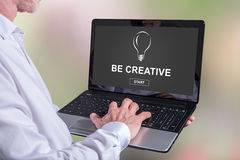 Be creative concept on a laptop. Man using a laptop with be creative concept on the screen Royalty Free Stock Photos