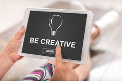 Be creative concept on a tablet. Woman using a tablet with be creative concept Stock Photo