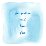 Be creative and have fun on blue watercolor background. Stock Photography