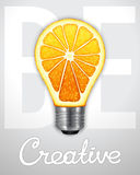 Be creative. Photorealistic light bulb in the form of an orange Stock Photo