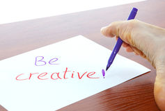 Be creative. Writing by the foot Royalty Free Stock Photo